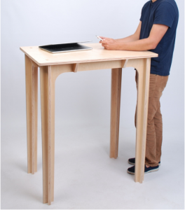 model stands at desk